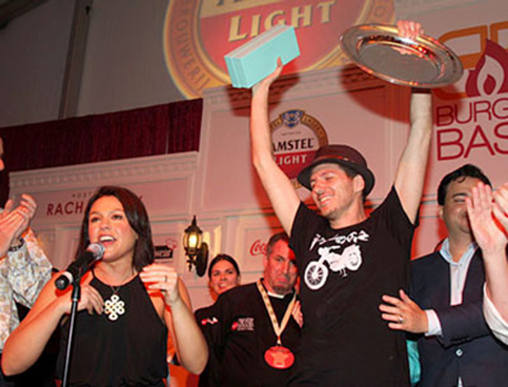 Host Rachael Ray congratulated Spike Mendelsohn on his victory, taking home all three of the evenings awards.