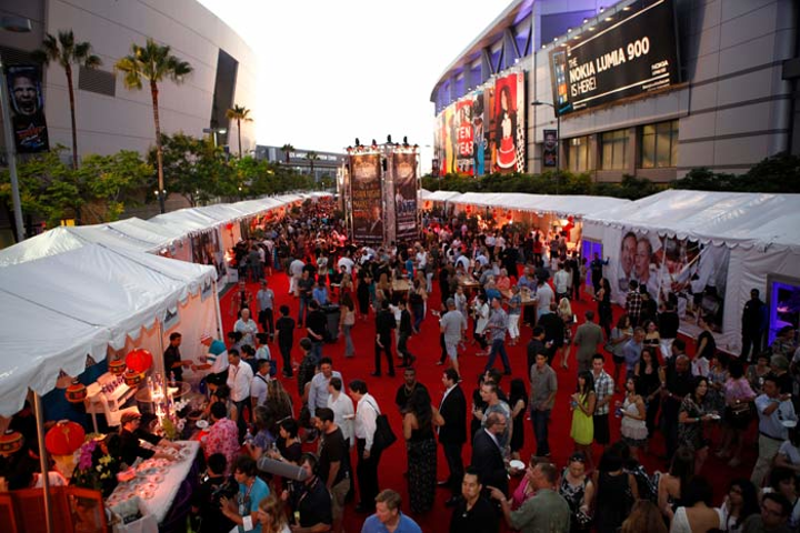 #1 Food, Wine & Hospitality Event (up from #10) In 2012, Los Angeles Food and Wine festival, presented by Food & Wine magazine, returned for the second year to L.A. Live and other locations around town. After resigning from the Puck-Lazaroff Charitable Foundation last year (and splitting with the foundation's 30-year-old American Wine & Food Festival), Wolfgang Puck was a part of the buzzy festival along with organizer Coastal Luxury Management, AEG, and Dick Clark Productions. Last year's inaugural event brought close to $5 million for the city's economy, and $400,000 for charity beneficiary St. Vincent's Meals on Wheels. New executive director Caryl Chinn led the event this year. Next: August 2013