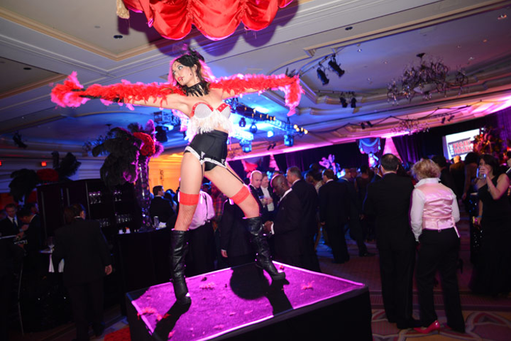Scantily clad burlesque dancers performed on platforms throughout the ballroom space at the Ritz-Carlton.