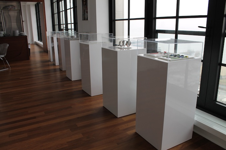 RentQuest's custom display cases showcase watches and jewelry at an event.