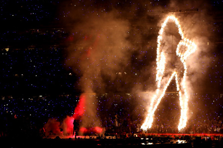 This year's Super Bowl halftime show kicked off with pyrotechnics, putting headliner Beyoncé on stage with a giant flaming silhouette of herself. One producer-reviewer called the opening sequence 'epic TV.'