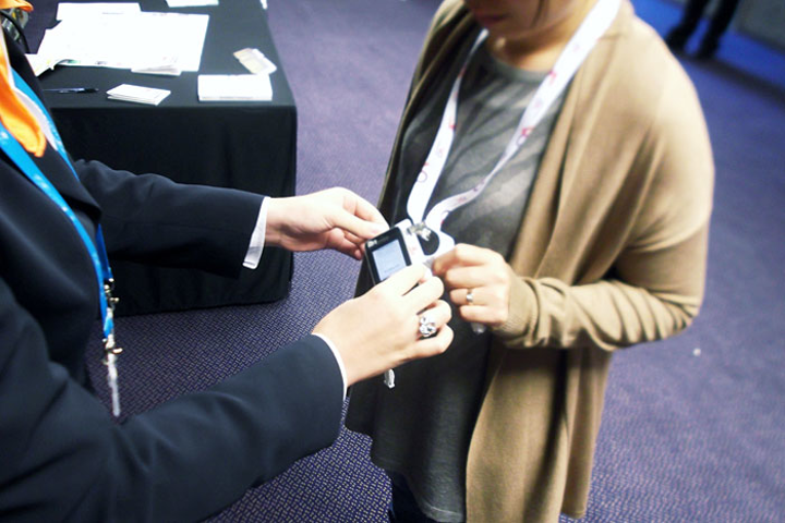 Room monitors can check in attendees by tapping an N.F.C.-enabled device to event badges embedded with an N.F.C. tag.