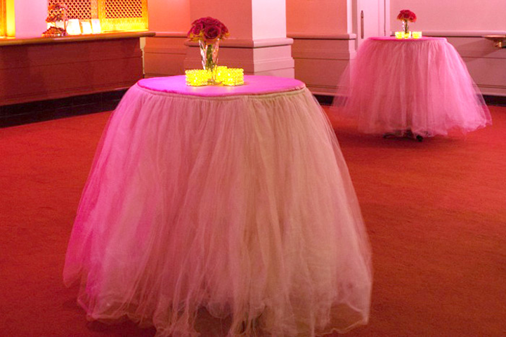 Clusters of hot pink roses topped the festive tables.