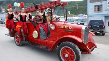 #12 Festival & Parade Dawson City, Yukon For more than a century, the town has celebrated its heritage with an annual summer festival that draws tourists and gold bugs to the Yukon community. Locals and visitors who make the trek to the beautiful Northern setting can ­experience old-time cancan dancers, walking tours of the historic gold rush town, an arts festival, a golf tournament, and Mounties in their iconic red serge uniforms. Next: August 2014