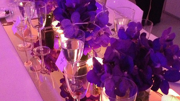 14. Travel & Leisure honored the winners of its World's Best Awards in July by hosting a seated dinner and presentation in New York. Banquet-style dinner tables were given a sleek, modern look with purple orchids and candles arranged atop mirrored runners. Click to Like, Comment, or Follow Us on Instagram