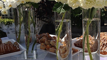 20. White hydrangea and orchids in tall vases decorated a buffet table at brunch for Miami's Pulse Contemporary Art Fair brunch in December. Click to Like, Comment, or Follow Us on Instagram