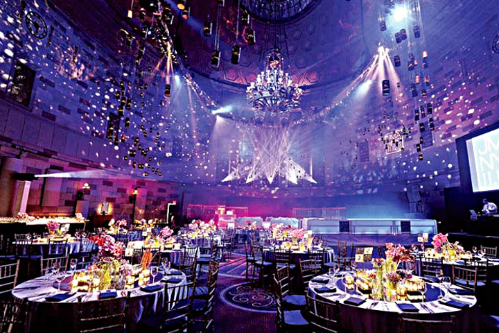 Ask your designer if he or she will stay for the event's entirety. Jes Gordon, who designed a bar mitzvah in New York (pictured), says her team remains on site for the duration of an event if they are overseeing audiovisual production. If not, they may leave at some point and return for load out.