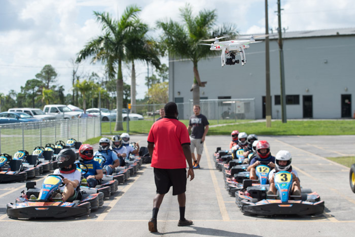 Drones can be useful to capture images of events that involve action, such as a teambuilding outing at a racetrack.