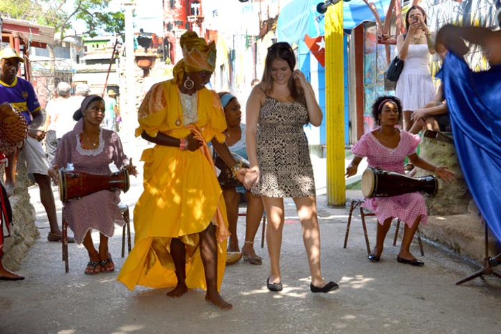 One of the people-to-people experiences offered by Cuba Explorations is a visit to Callejón de Hamel, an area in Havana known for Afro-Cuban art and Santeria rituals with rumba dance sessions.