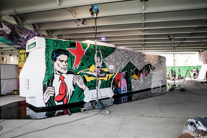 Three Toronto artists painted canvas streetcar replicas using Heineken's color palette.