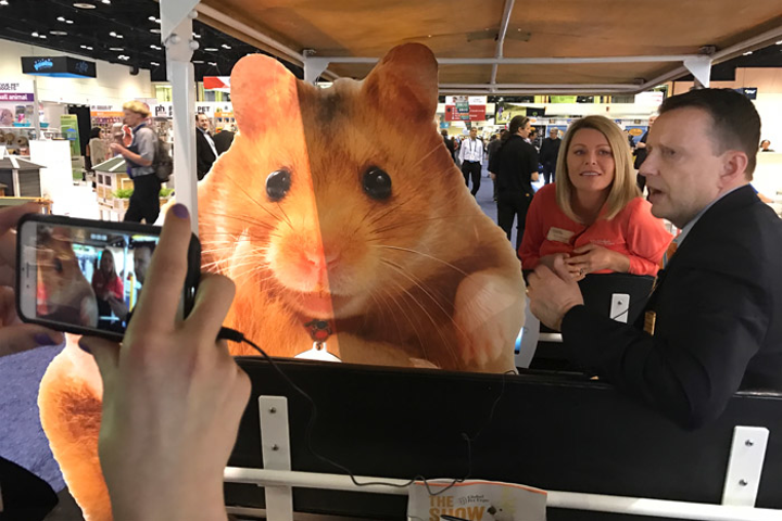 The Global Pet Expo's new social media mascot, Hamlet the Hamster, joined American Pet Products Association executive vice president Andy Darmohraj during a Facebook Live tour of the show floor Wednesday morning. Organizers created the five-foot-tall cutout of a hamster—and the hashtag #hamletthehamster— to create a fun photo opportunity for attendees.