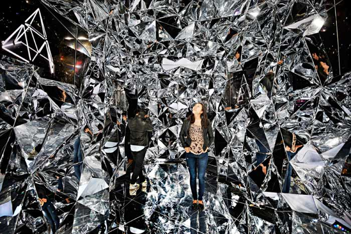 The audiovisual tunnel was created with reflective geometric panels and six of Sony's A1E Bravia OLED televisions, which broadcasted images including 3-D triangles that resembled the installation's design.