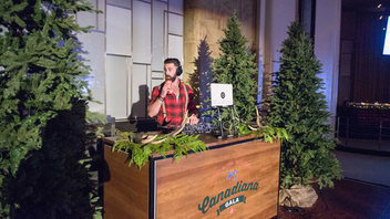 A forest-inspired DJ booth featured a DJ dressed as a lumberjack.