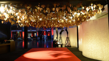 The red carpet area featured a ceiling installation of golden maple leafs, along with black cutouts of moose silhouettes.