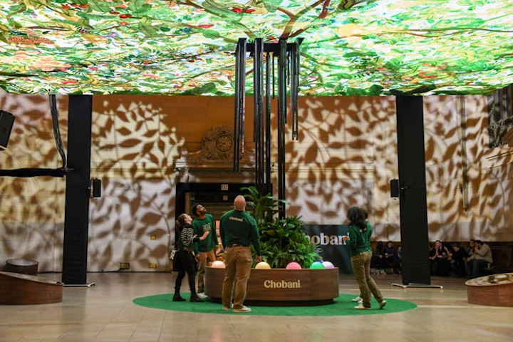 The installation invited passersby to press sensory buttons at the base, which shot up beams of light that created animated fruit in a digital canopy.