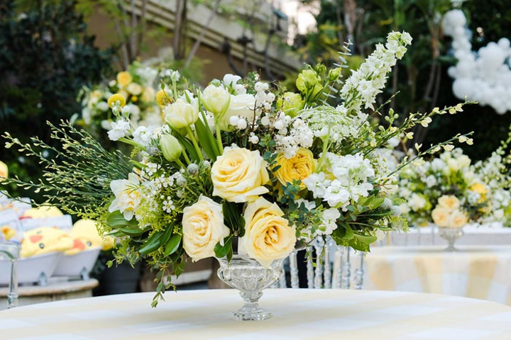 Every element of the party—including large floral centerpieces from Celio's Design—tied into the event's summery color scheme of yellow, white, and blue.