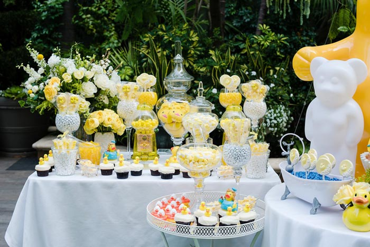 'The dessert table is always very important to us,' explained event producer Clarissa Rezende. The oversize station tied into the theme with yellow flowers and candy and duck-shaped desserts.