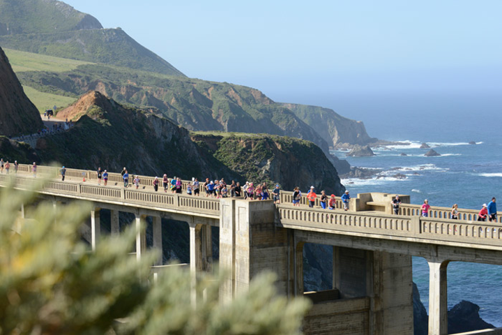 #3 Sports Event The Big Sur Marathon is the most scenic race in North America, according to Runner's World. The 32-year-old event hugs the rugged California coast, testing runners with hills, valleys, uneven terrain, and a firm six-hour time cap. Given the spectacular views—and the opportunity to run across the iconic Bixby Bridge—the race remains relatively small: In 2018, there were 10,000 registered runners for race weekend events, including 4,700 marathon runners. Next: April 28, 2019