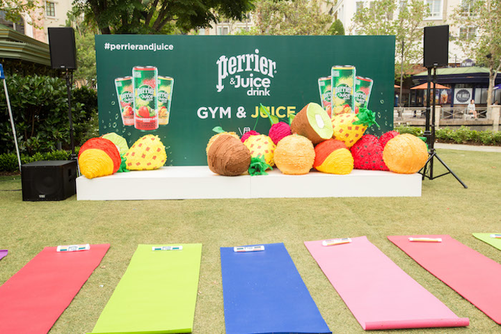 "To celebrate the launch of Perrier & Juice, a new product made with mineral water and real fruit juices, Perrier hosted a ""Gym & Juice"" pop-up at the Americana at Brand in Glendale in late August. A partnership with Y7 Studio, the event featured Vinyasa yoga sessions, live DJs, and fruit-theme photo ops."