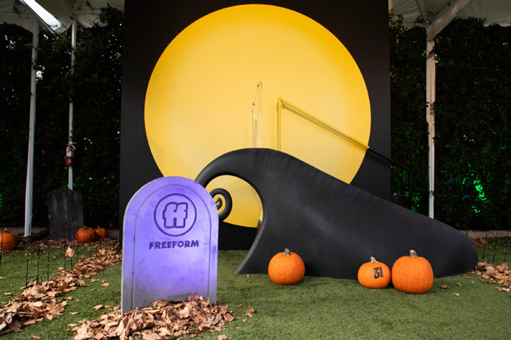 """From October 4 to 9, Freeform worked with MKG to transform the Lombardi House into a celebration of the 25th anniversaries of both Hocus Pocus and The Nightmare Before Christmas. Immersive rooms were designed after Mr. Oogie Boogie's Lair, Dr. Finkelstein's Lab, the Sanderson Sisters' cottage, and more, and a fun photo op allowed guests to pose like Jack Skellington on Spiral Hill (pictured). The activation, which drew over 8,000 attendees and an additional 30,000 on the wait list, was part of the network's """"31 Nights of Halloween"""" programming."""