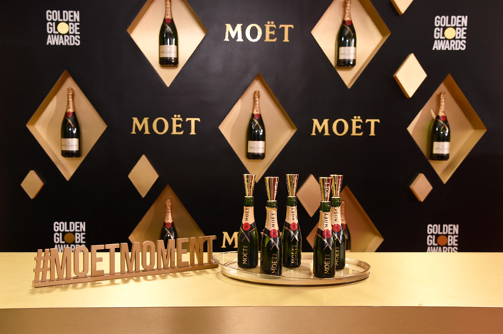 As the official champagne of the Golden Globes, Moët & Chandon had a stylish product display and bar on the red carpet at the Beverly Hilton. Guests were offered mini bottles and could pose for social media-friendly pictures with a #MoetMoment sign.