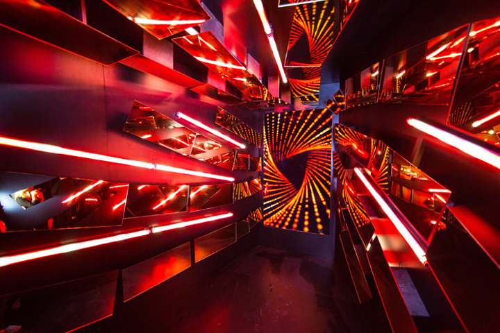 A psychedelic, neon-lined photo booth added to the nightclub vibe.