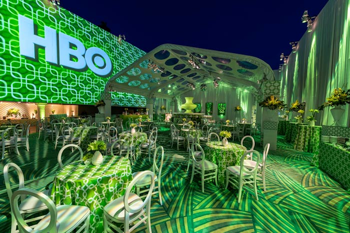 HBO's Sunday-night party was held at the Beverly Hilton's Circa 55 restaurant and Aqua Star Pool. The network's Cindy Tenner and Ashley Covarrubias worked with longtime collaborator Billy Butchkavitz and his brother, Brian Butchkavitz, to create a late 1950s/early 1960s-inspired space that used a white and chartreuse color scheme. Due to the location within the hotel, organizers had just 72 hours to set up (and just 14 hours inside the restaurant). Special Event Contractors created 24-foot perimeter walls to conceal two floors of hotel rooms, plus a pool sub floor. Meanwhile, Agile Eye Solutions handled all large-scale decor elements, including the press wall, and SoCal Tents created custom tenting. Animated projections by Bart Kresa decorated the hotel's surrounding walls, and Images by Lighting handled lighting.