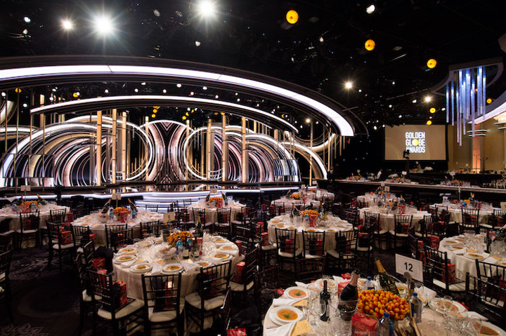 The Beverly Hilton has served as the venue for the Golden Globes a total of 48 times. This year, roughly 1,300 guests attended the live telecast, dining on a three-course meal by the hotel's catering team. Floral centerpieces by Mark's Garden featured more than 15,000 vibrant Rambo tulips, flown in from Holland and displayed in textured gold vases that were inspired by the Golden Globe statuette.