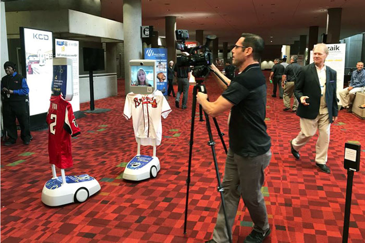 Virtual attendees could visit exhibits via robots controlled from their computers.