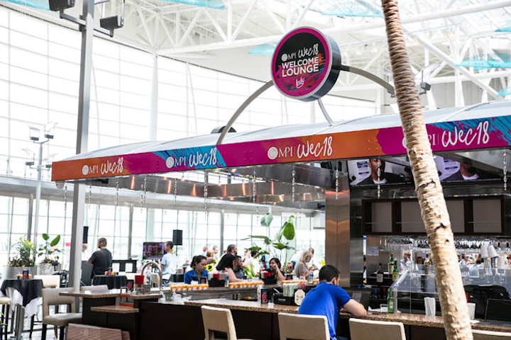 M.P.I. took over an airport bar and turned it into a welcome lounge for attendees.
