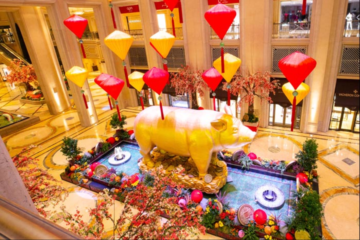 To celebrate Chinese New Year, the Venetian in Las Vegas unveiled an installation inspired by the Year of the Pig. The resort's floral and horticulture team partnered with a team of artisans and consulted a feng shui master to create an installation anchored by a 3,000-pound, 16-foot-tall golden pig. Additional decor included hanging Chinese lanterns and a base of giant gold coins. According to custom, it is suggested to guests that they walk clockwise around the display three times to bring blessings of heaven, earth, and mankind upon them.