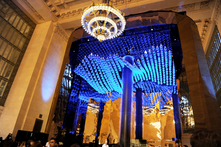 In March 2018, Stella Artois and Water.org unveiled a public kinetic art installation at Vanderbilt Hall at Grand Central Terminal in New York. The 36-foot installation was composed of 558 kinetic droplets made from thin, vacuum-formed polystyrene plastic—each of which were hand-painted on robotic, rotating droplet holders. The droplets, which were created by collaborative art, design, and technology studio Hypersonic, were connected with 15,700 feet of cable and 6,000 feet of wire. Passersby were invited to touch the center column in the installation, which initiated a ripple movement that made the droplets move in unison. conceptualized by creative agency Mother New York and executed with creative digital production company MediaMonks. See more here: Watch: See a Water-Inspired Art Installation Created With Close to 600 Kinetic Droplets