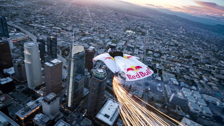 Members of the Red Bull Air Force wore branded, LED-equippred wingsuits while jumping from a helicopter 4,000 feet in the air.