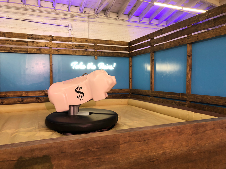 Visitors can ride a mechanical pig in the Retirement Rodeo, presented by Charles Schwab, and learn the value of compound interest.