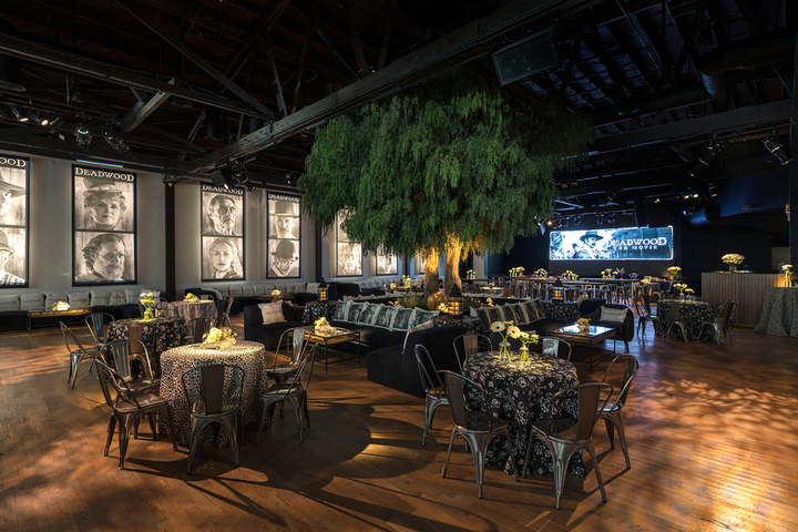 To celebrate Deadwood: The Movie, which premieres on HBO today, the network's Lauren McMahon worked with longtime collaborator Billy Butchkavitz on an immersive Western theme. Held on May 14 at the Sunset Room in Hollywood, the event had a Western feel with an 18-foot tree and a mausoleum wall from Agile Eye Solutions. Additional vendors included Images by Lighting and Town & Country Event Rentals; Plan-it Interactive created a casino, and a jail cell photo op had photography by MirMir.