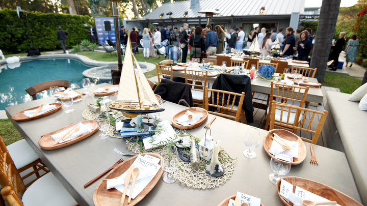 Apparel brand Nautica teamed up with actress Brooke Burke to host a benefit dinner for the Nautica Malibu Triathalon and Children's Hospital Los Angeles. Held in Malibu in late April, the summery event had centerpieces with sailboats and other appropriately nautical props from Host Boutique Events, plus a catered dinner from plant-based chef Tal Ronnen.