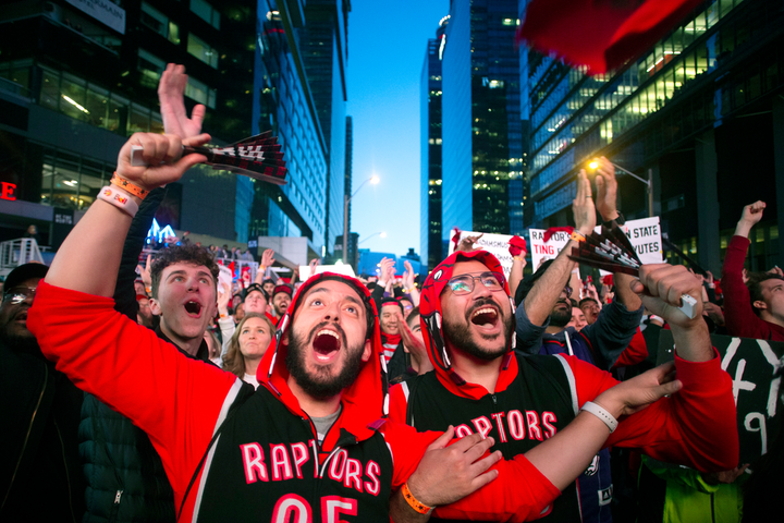 Toronto Raptors fans watch Game 2 of the N.B.A. Finals in Jurassic Park, outside Scotiabank Arena in Toronto, on June 2.