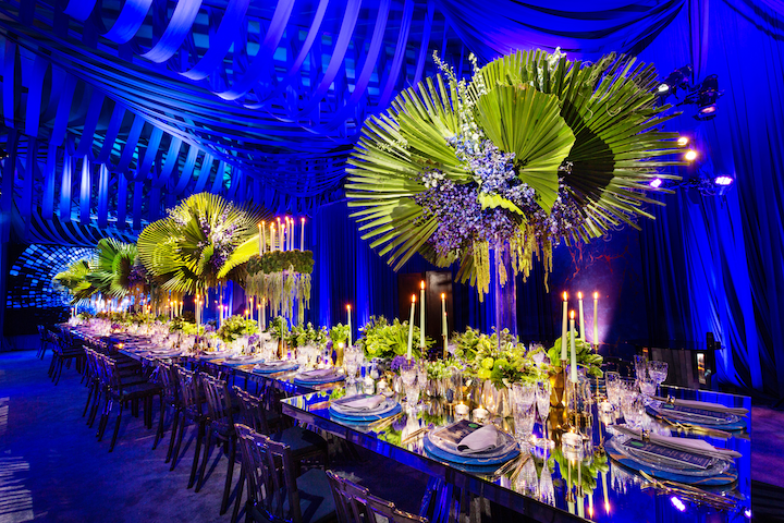 """The dining scene was set with elaborate custom draping and [the company's] Berlin rectangular and square chrome dining tables were topped with glowing candles and centerpieces. Patterned china, gold flatware, and lush florals were reflected on the mirror-top tables for the intimate gathering. The tables reflected the abundance of textured greenery and candlelight that filled the tablescape."" Pictured: Zamora and husband Celio De Almeida's second anniversary party"