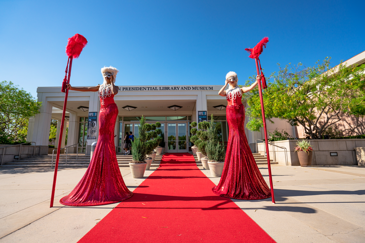 MPIOC hosted its awards and installation dinner at the Richard Nixon Library & Museum in Yorba Linda on June 12. The red carpet was flanked by live entertainers from Champagne Creative Group, while the pink-hued dining space was inspired by Nikolo Kotzev's Nostradamus Rock Opera and Sofia Coppola's Marie Antoinette. Elite Productions International handled event design and florals, while rentals came from Bright Event Rentals.