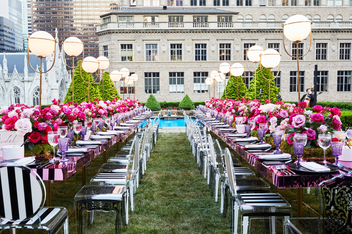"""The venue overlooks Fifth Avenue and St. Patrick's Cathedral, and it was breathtaking in design. For the wedding, we completely transformed the New York Public Library. We created these walls made of oversize printed white roses that were each 8 feet in circumference."" Pictured: Rehearsal dinner at 620 Loft & Garden"