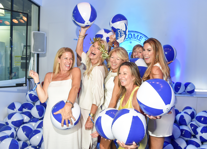 Guests posed in a Mykonos-theme beach ball pit at Eatertainment's third annual Beats & Eats bash.