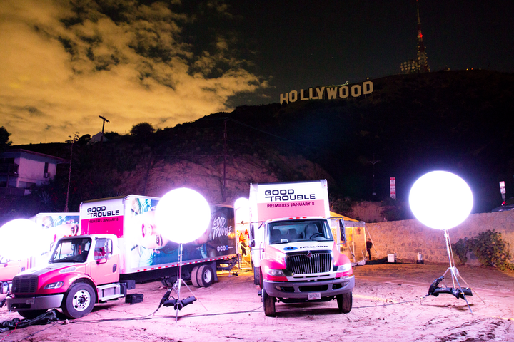 Freeform promoted the series Good Trouble in December 2018 with a communal dining experience that was housed in three large moving trucks under the Hollywood sign in Los Angeles. The trucks were branded with Freeform and Good Trouble signage, and the back of each opened to reveal three distinct, design-forward dining rooms inspired by the show's themes of friendship, love, and young adulthood. Freeform partnered with Blue Revolver to produce the event. See more: Would You Host a Dinner Party Inside a Moving Truck?