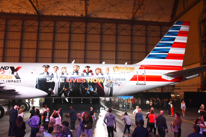 As part of a P.S.A. campaign, American Airlines, Stand Up To Cancer (SU2C), and Marvel Studios unveiled a custom-wrapped American Airlines aircraft in April 2018 at Los Angeles International Airport. The graphic, which was more than 50 feet long, depicted characters from Avengers: Infinity War alongside the nonprofit's logo, images of SU2C researchers, and images of American Airlines employees who are cancer survivors. Solo Graphix created the custom-wrapped graphic for the plane, which flew to and from New York and Los Angeles. Lindeman & Associates designed the creative. American Airlines also unveiled a similarly wrapped plane in September, as part of a partnership with Stand Up To Cancer and Hyatt Regency. See more: 10 Best Ideas of the Week: National Geographic's Picasso-Theme Photo Ops, a Hanging Condom Installation, Absolut's LED Dance Floor