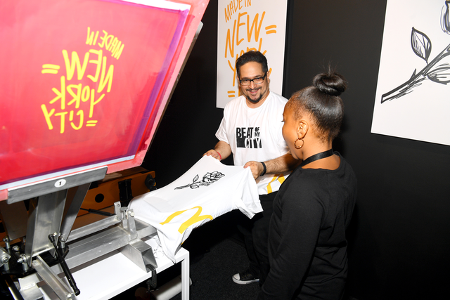 The New York event had a screen-printing station that offered guests T-shirts displaying the McDonald's logo and an illustration of a rose inspired by Taylor's song, 'Rose in Harlem.'