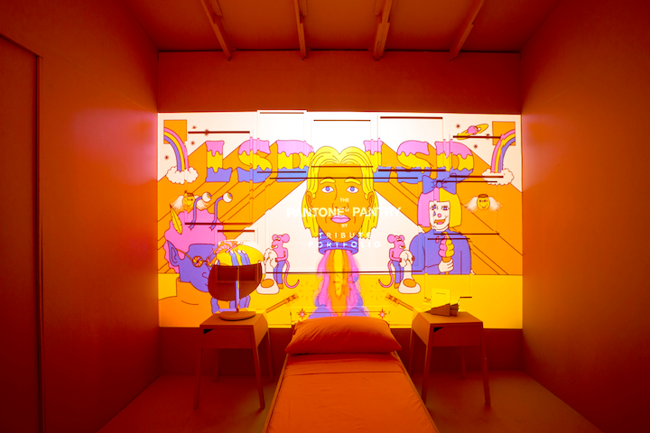 """Tribute Portfolio, Marriott International's collection of independent hotels, debuted the """"Pantone Pantry by Tribute Portfolio"""" at Art Basel in Miami in 2018. The travel-inspired installation highlighted """"Living Coral,"""" the 2019 Pantone Color of the Year, and marked the first time the announcement included an experiential reveal. The Miami installation was created by interior designer Athena Calderone, pop-art illustrator Gabriel Alcala, and Supergroup LSD, which created projection artwork for the activation."""