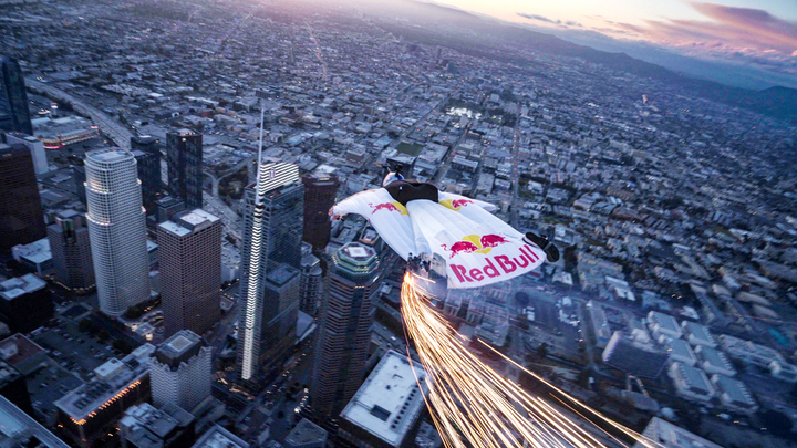 To celebrate the last supermoon of the decade and to ring in the vernal equinox, Red Bull teamed up with the InterContinental Los Angeles Downtown hotel for the first wingsuit jump into downtown L.A. Members of the Red Bull Air Force wore branded, LED-equipped wingsuits while jumping from a helicopter 4,000 feet in the air.