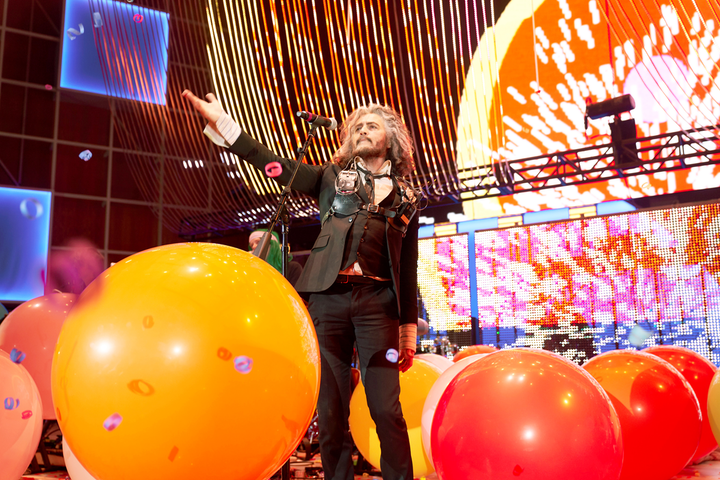 In one buzzy moment from Google I/O's festival-style evening events, Wayne Coyne from the Flaming Lips performed a song accompanied by A.I.-enabled inflatable fruit.