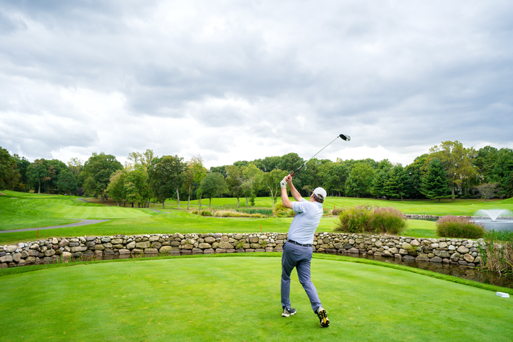 A player tees off during the inaugural Celebrity Chefs & Friends Golf Tournament.