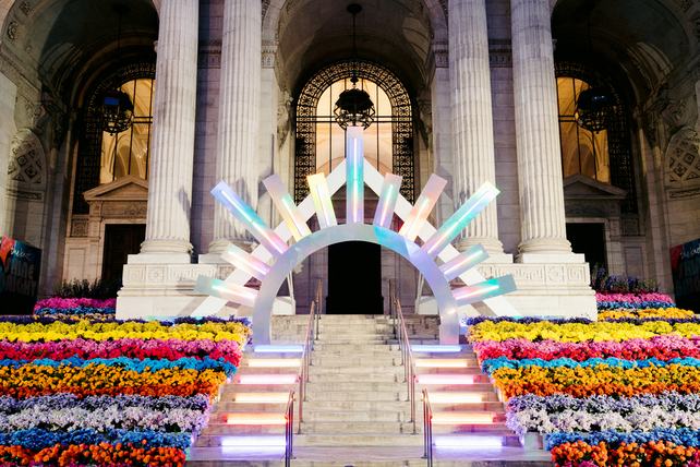 """The 10th annual Knot Gala, which took place November 11 at the New York Public Library, featured the theme of """"Shine Bright"""" and was planned and designed by Jove Meyer, creative director and owner of Jove Meyer Events. Guests were greeted by a rainbow floral installation and an illuminated sunburst entryway."""