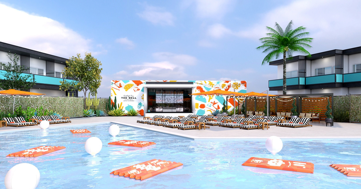Taco Bell's themed hotel, which took place in Palm Springs from August 8 to 12, included an expansive outdoor pool and deck with floats, lounge chairs, and colorful brand imagery.